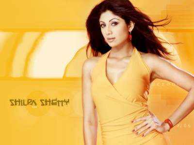 Shilpa Shetty in yellow dress Click for Wallpaper